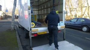 A mover loading his van